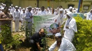 Secretary Shakeel Ahmed and Ajay Rajuka Planting the Tree