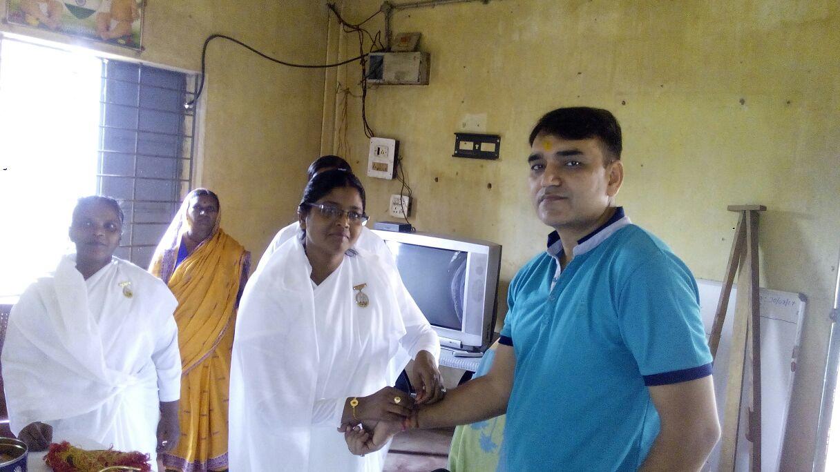 Sister tying rakhi to CRPF Asst Commandant